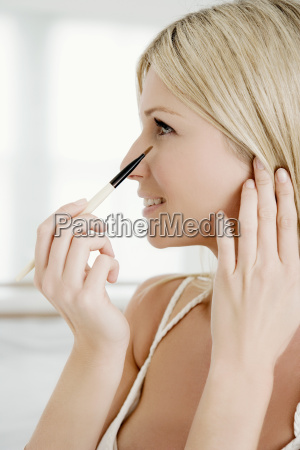 woman with eye shadow brush