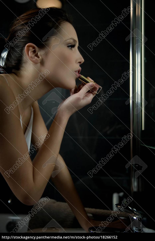 woman, applying, lipstick - 18266152