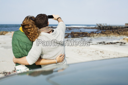 rear view of young couple leaning
