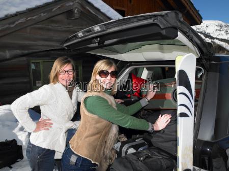 young women packing car