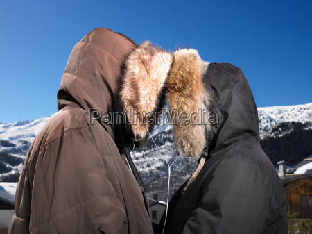 couple listening to music at mountains