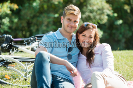 happy young couple in park