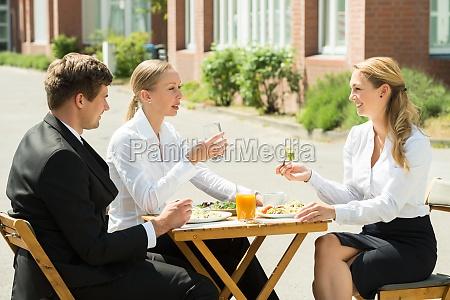 businesspeople eating food
