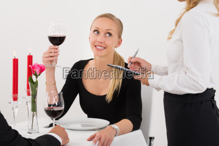 waitress taking an order from a