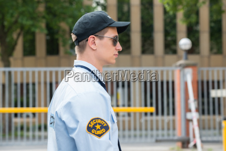 young male security guard in uniform