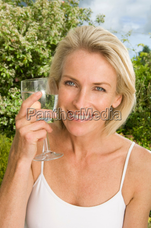 portrait of woman with glass of