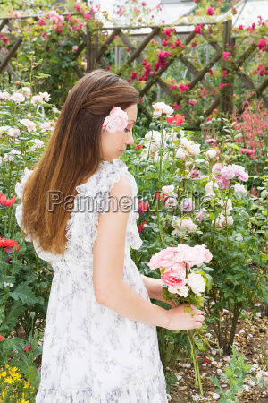 woman holding roses side view