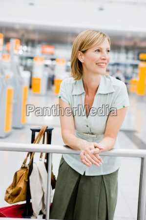 woman leaning on rail waiting