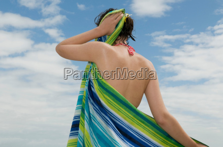 girl drying her beach hair