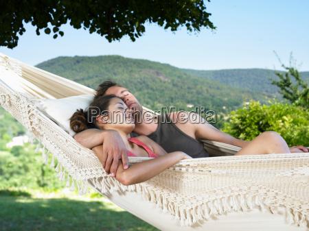 couple asleep on hammock