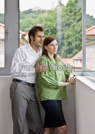 man and woman looking out the