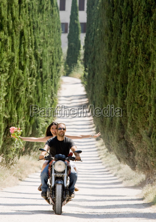 man and woman riding on a