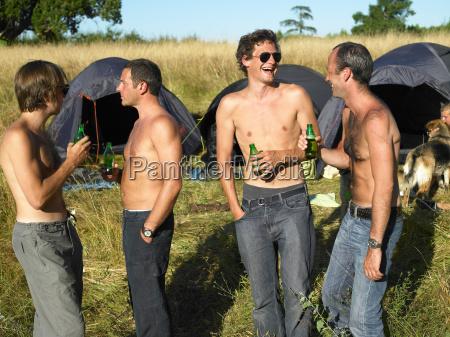 men drinking beer at a festival