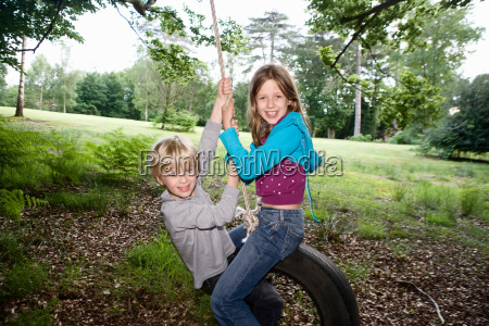 boy, and, girl, on, tire, swing - 18271084