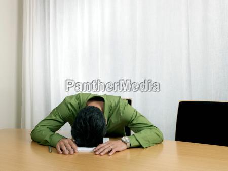 business man by desk head