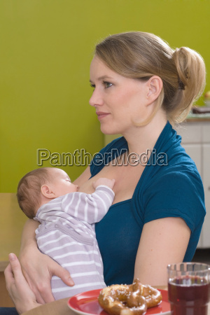 young woman breastfeeding her baby