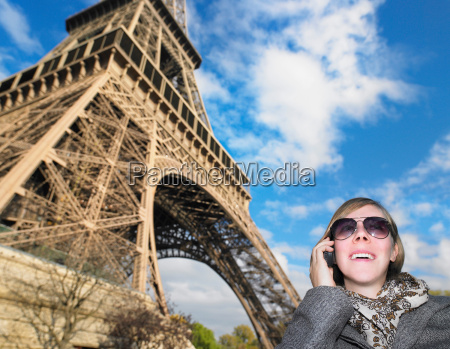 woman on phone in front of