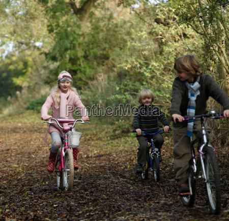children riding bikes in countryside