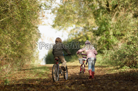 boy and girl riding bikes in