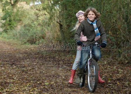 boy and girl sharing bike in