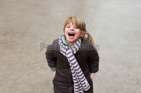 portrait of girl laughing yelling