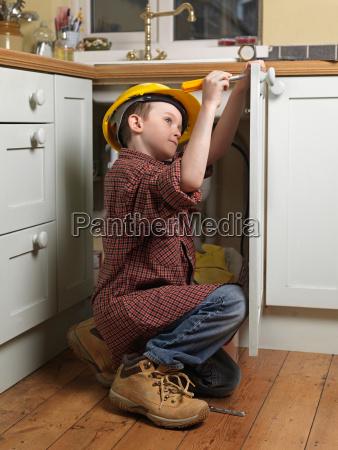 boy dressed as repair man