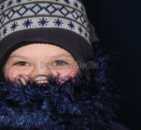 girl wearing hat and scarf close