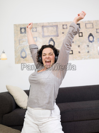one woman exulting with headphones on