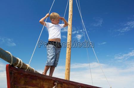 boy on sailing boat