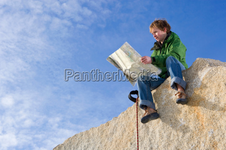 climber looking at map