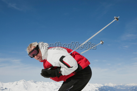 mature man preparing to ski
