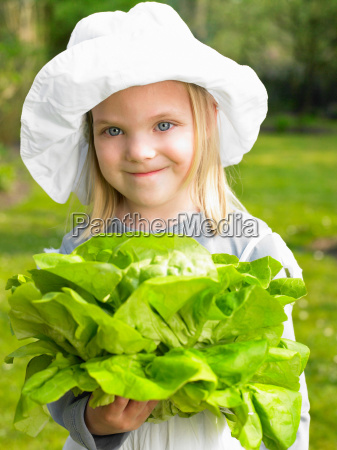 girl holding a salad from the