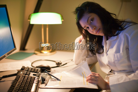 female doctor working at desk at
