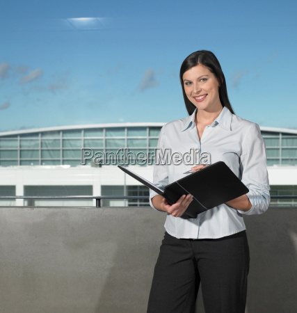 businesswoman, smiling, , holding, book - 18273444
