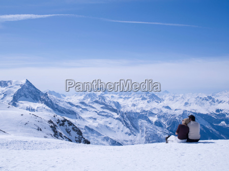 couple sitting in the snow hugging
