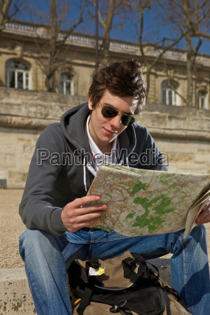 man looking on the map