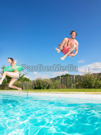 people jumping into pool