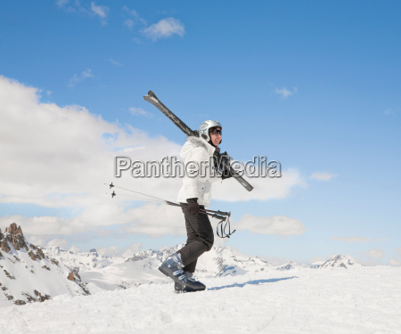 woman walking up hill in snow