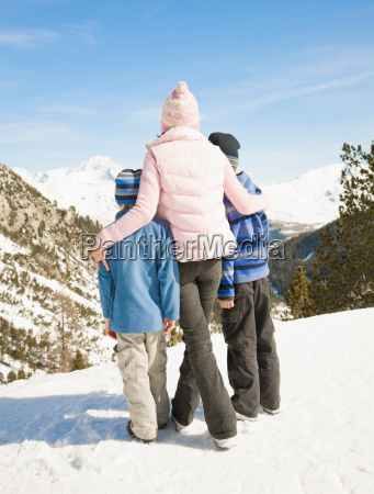 woman and two boys in mountain