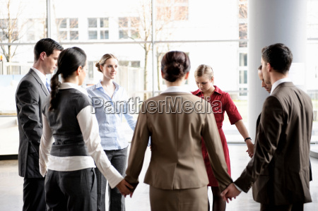 group of business people forming circle