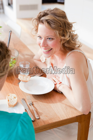 two woman sitting at the table