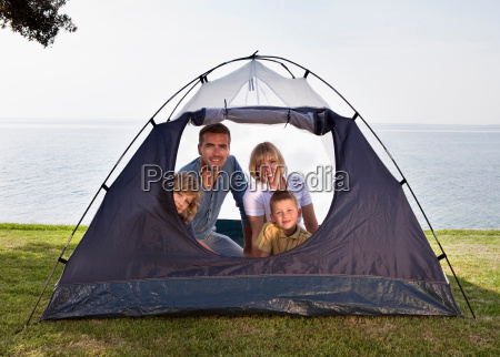 family camping with tent by sea