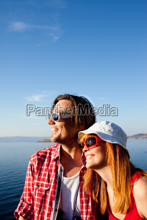 young couple looking to sea