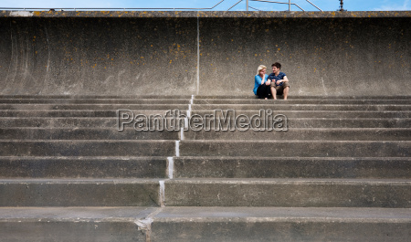 couple sitting together on steps