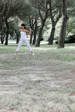 woman stretching in a park