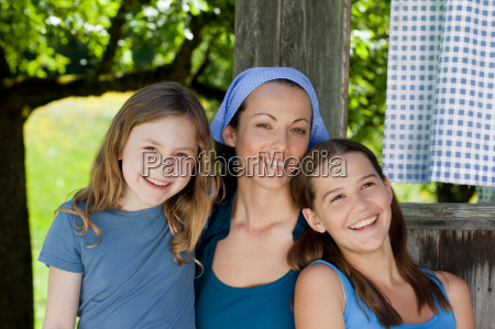 portrait of mother and daughters happy