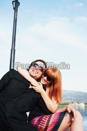 woman holding man in headlock