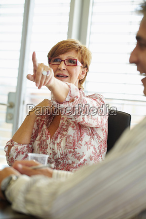 older business woman in meeting