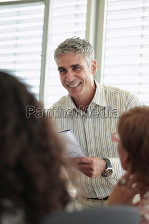 smiling business man in discussion