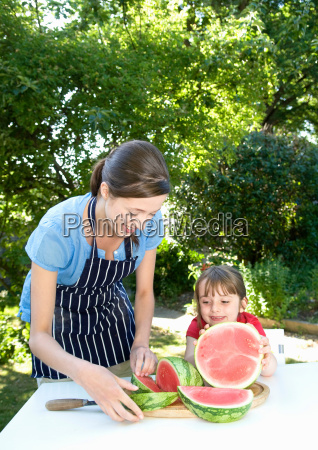 mother and daughter prepare water melon